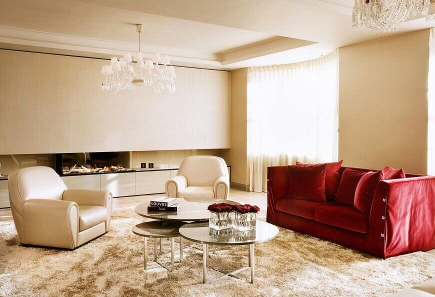 A Single Rich Red Sofa Adds Bold Color To This Otherwise White Living Room,  And