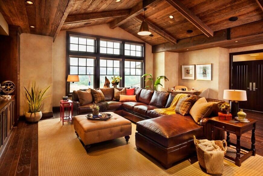 When matched with an all-wood rustic arched ceiling, this leather sectional with a chaise takes on a much more rustic style. Warm, earthy tones are standard throughout this design.