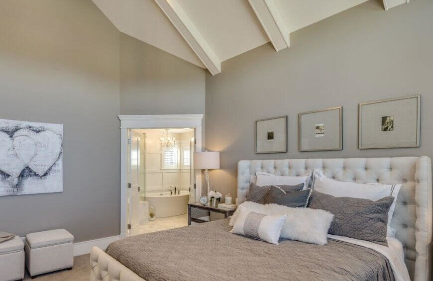This simple contemporary bedroom exudes a bit of a rustic feel from the tufted linen headboard and lovely grey quilt.