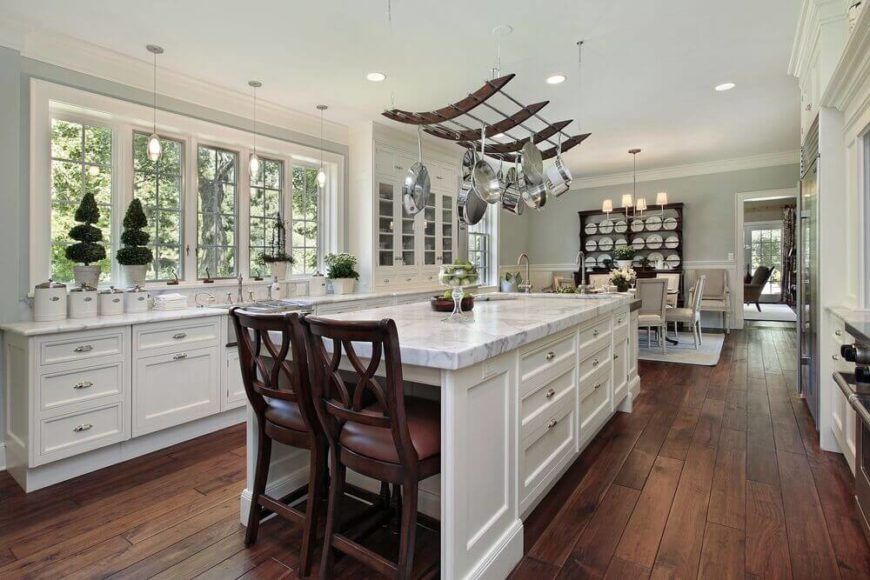 Bon Luxurious Modern Kitchen With Elegant Pot Rack Hanging Over The Marble  Topped Island.