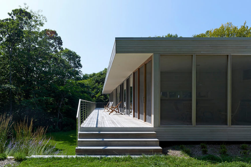 The lengthy deck spans the entire breadth of the home, flanked nearly the entire way by sliding glass panels for access from anywhere within the home.