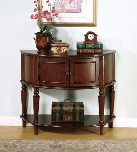 Two doors open to reveal the inside of the table with plenty of room to store your possessions. The lower shelf can be used for display, or for more storage