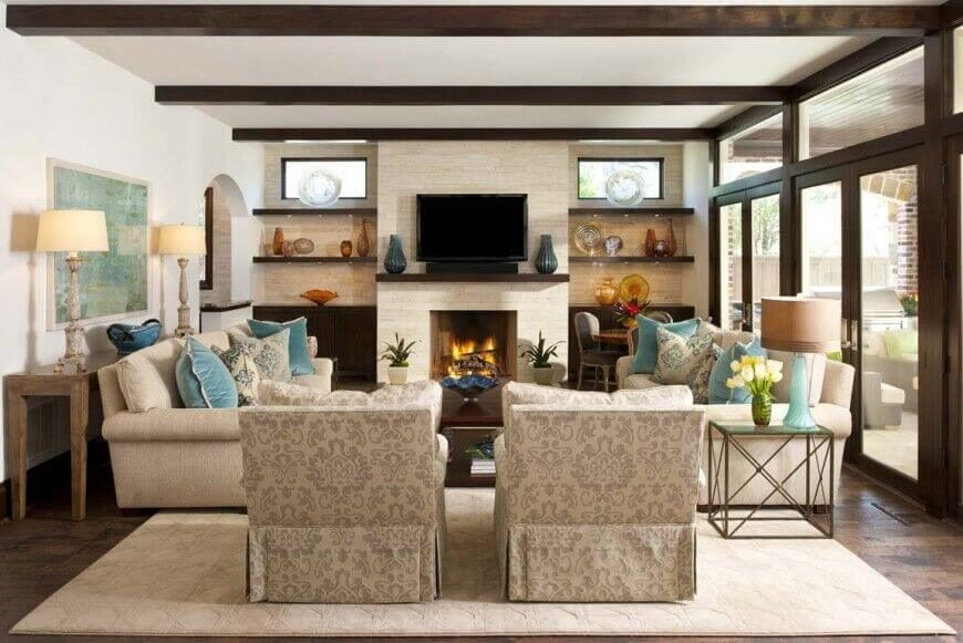 The fireplace and television in this room are placed perfectly in the living area. The warmth of the fire and the entertainment of the TV can be accessed by any of the seating arrangements in the room.