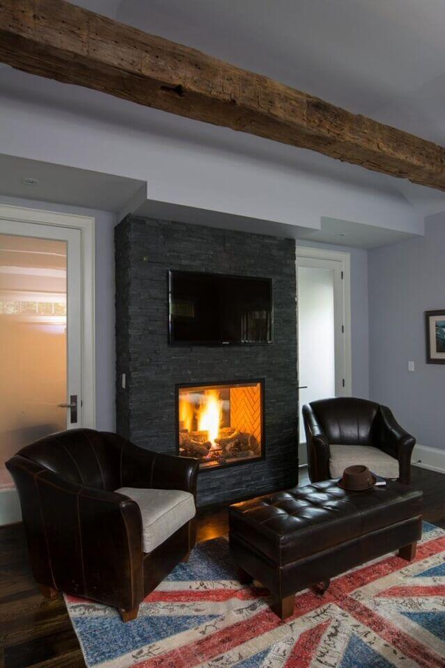 This Dark Stone Mantle Contains A Roaring Fire For A Peaceful Reading Area.  A Television
