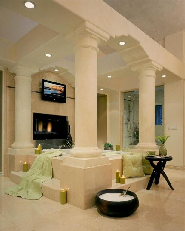 How about a fireplace and a television in the bathroom? Enjoy the relaxing TV and burning coals from a large jacuzzi during your next home spa day.