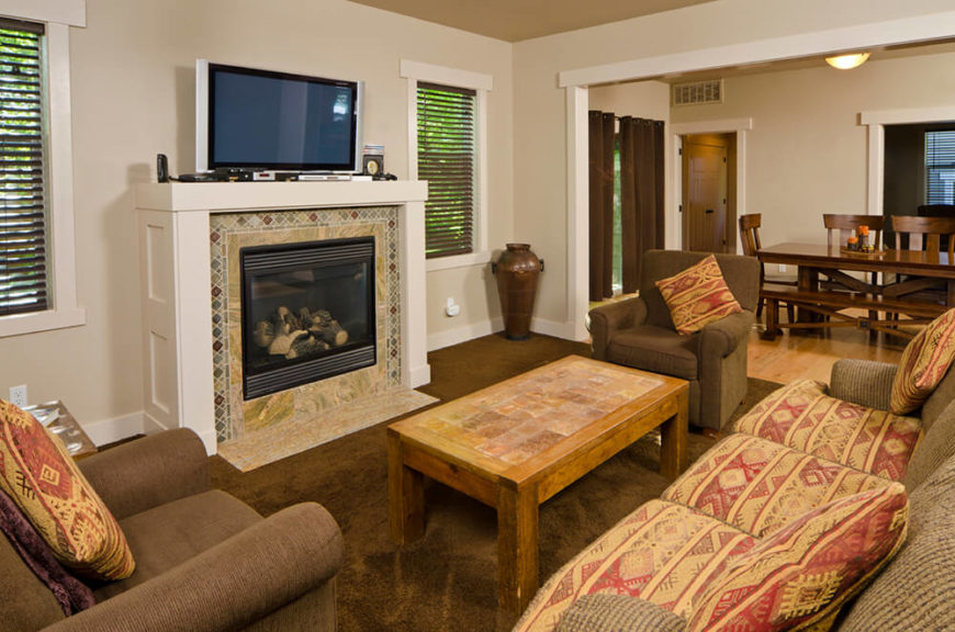 This traditional living room can be used to relax by the fire with the family, or enjoy the game on the flat screen. The choice is yours when you have a gorgeous fireplace with a television sitting on the mantle!