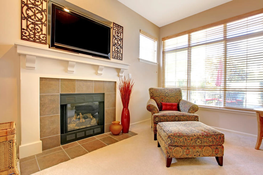 The television and fireplace can be placed in any room of the house. This fireplace is at the perfect level to warm the feet on the ottoman while reading, beside the fire. The television is placed to be seen throughout the room.