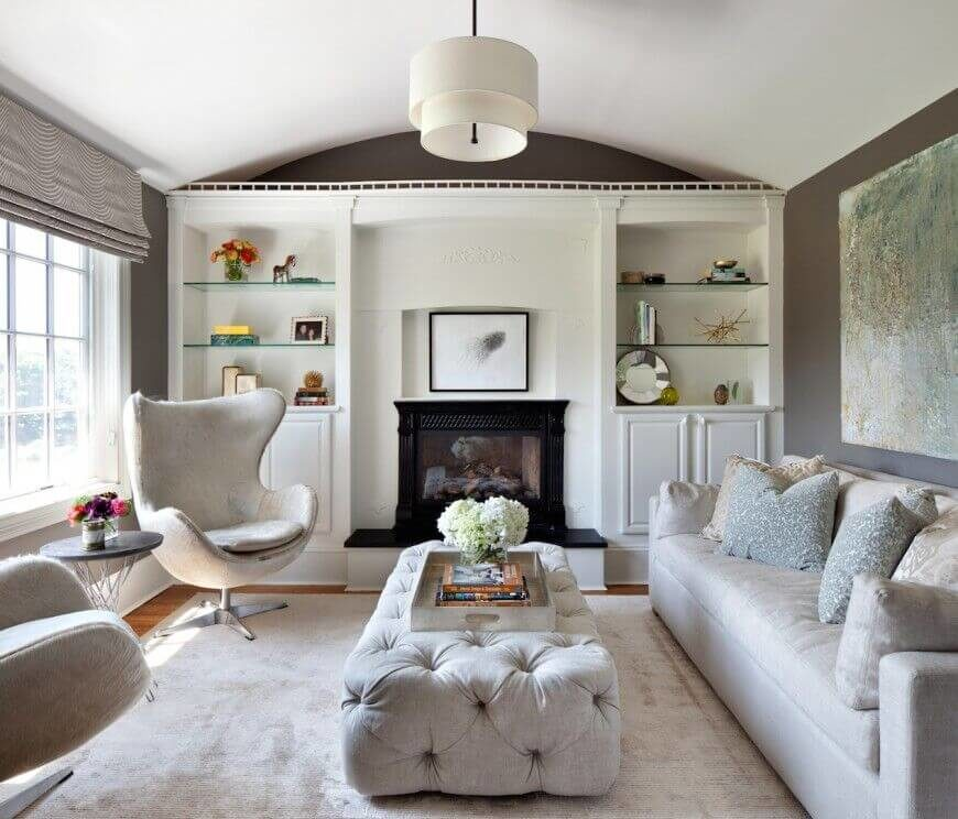 An Elegant Button Tufted Rectangular Ottoman Adds Texture And Warmth To This Lovely Living Room