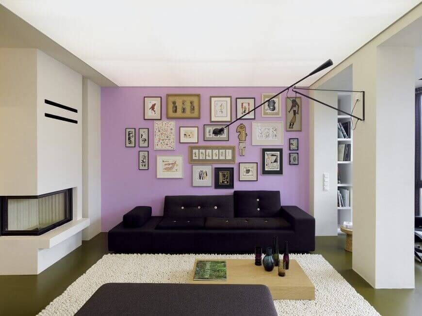 This Light Lavender Accent Wall Is Filled With An Array Of Prints And  Artwork That Take