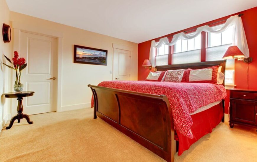Bold Red Colors Accent This Bedroom, While The Light Colored Walls And  Carpet Balance The