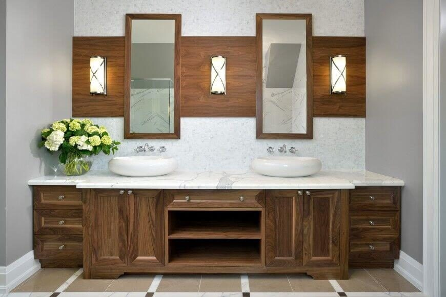 This Symmetrical Design Features Identical Sinks Above A White Granite  Countertop, Contrasted By The Dark