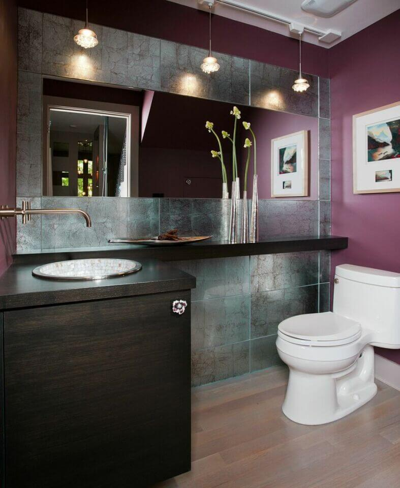 deep dark colors are prominent in this bathroom as even the light hardwood floor