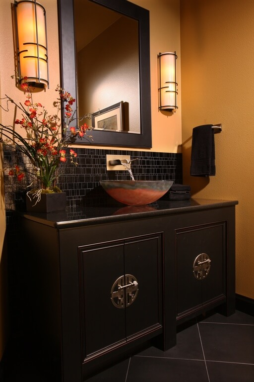 A Bold Colored Bathroom, The Sleek Cabinets And Black Tile Backsplash  Contribute To The Overall