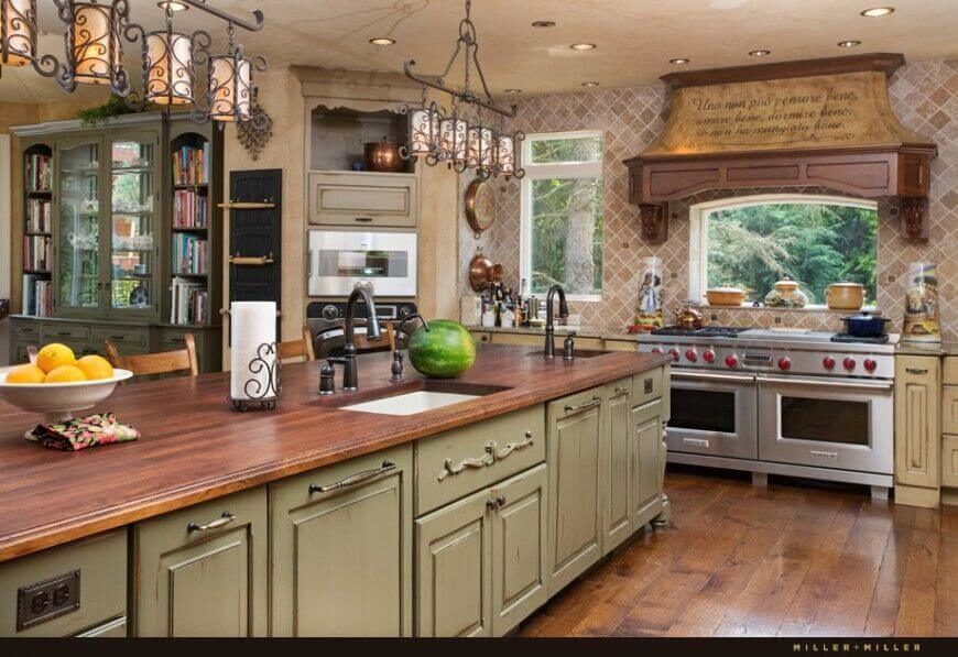 These delicate pendant lights add a whimsical touch seen throughout this kitchen. Though beautiful these lights would create soft pools of light on the island, but would do little to light the rest of the room on their own.