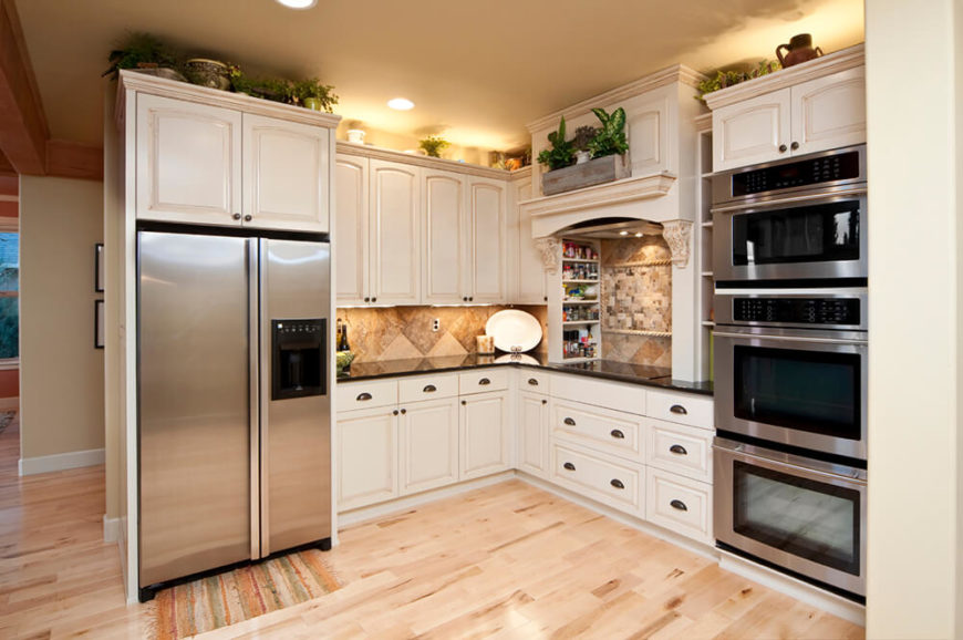 Recessed lighting helps to create a great ambient glow around the room and ensure that every space is well lit. Can lights are a common form of recessed lighting, as seen here.