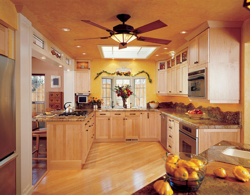 One large skylight in this room brightens up the space considerably while can lights help to brighten up the counter space better for those working in the kitchen.