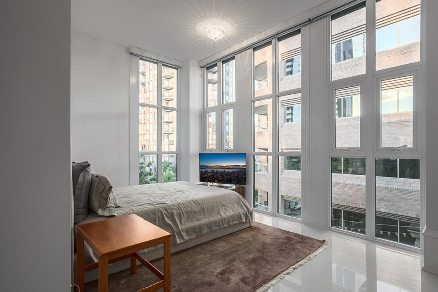 The master bedroom is located on the outside of the building, and is surrounded by large windows. The area is very minimalist, and doesn't require a lot of furniture for a truly spectacular design.