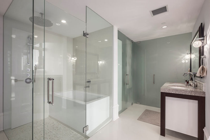 There are multiple bathing places in the luxurious bathroom. Two showers with rain fall showerheads, as well as a square bathtub, provide the residents with a place to soak and relax.