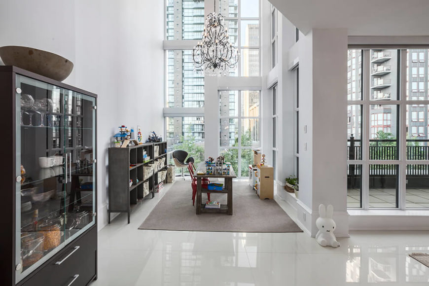 This office, another part of the open floor plan, is secluded from the rest of the house without being totally cut off. Branching off of the dining room, this space has an astounding view of the city as well as a luxurious chandelier for extra light and class.