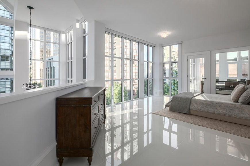 The master bedroom is on the second floor of the home, and can see down into the office space from the balcony area. Because of the half wall, the master bedroom gets twice as many windows as other bedrooms in the house.