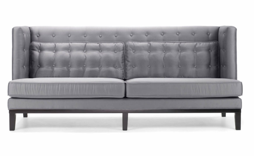 The bright silver tone of this sofa invites a closer look, revealing bespoke button tufting and thick pillow back. The angular, upright frame makes for a timeless look that straddles the line between traditional and contemporary style.