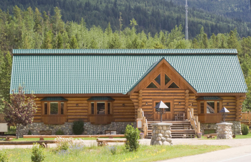 this split log style maintains the cabin feel of this mountain lodge split log siding