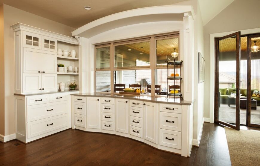 In This Kitchen Space Rich Stained Wood Flooring Meets White Cabinetry And Creates A Strong