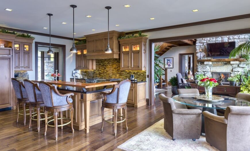 Covered In Rich Wood, And Featuring Intricate Detail, This Kitchen Is  Refined And Comfortable