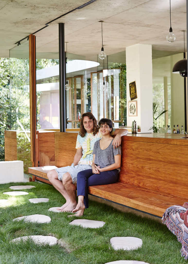 Here the homeowners show off some of the built-in comforts of the home, including an outdoor bar that connects to the kitchen and breakfast nook area.