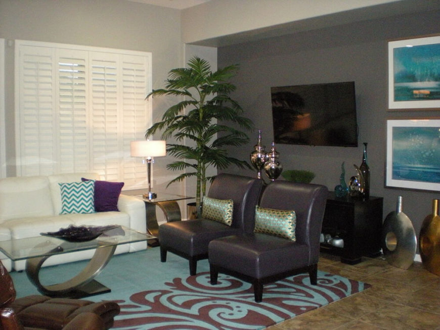 Tall accents of green balance the use of violet and sea blue throughout the room, both complimenting and contrasting the colors. Modern contemporary furniture fits the space well.