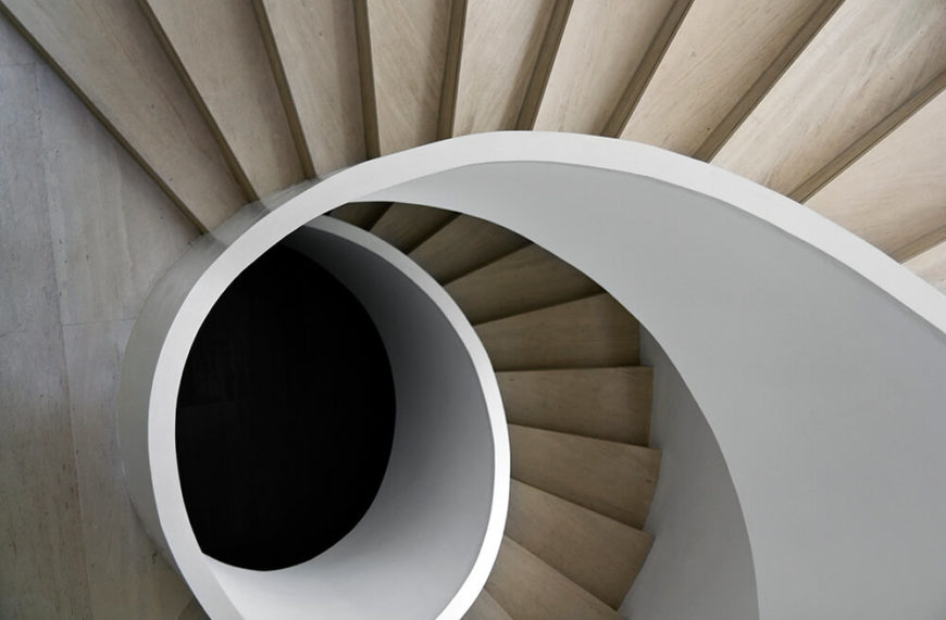 Peering directly down the spiral staircase, we enjoy a novel sense of vertigo and disorientation, as the organic curves and sharp stair lines create a nearly psychedelic effect.