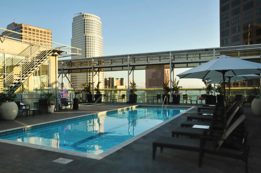 Surrounded by quiet seating areas, this pool plays center point to this patio space. Creating an area of respite amidst the bustle of the surrounding city, this quiet location is a great place to relax.