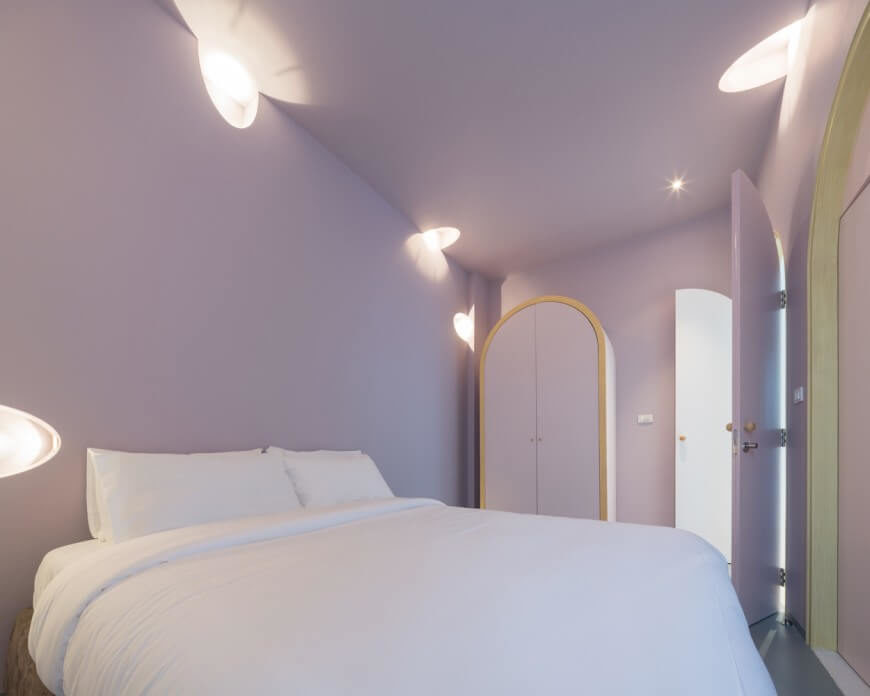 In true Onion fashion, clean lines and simple colors showcase in this room. Lavender walls and bright white accents - in the bed and light features - create a clean and welcoming atmosphere. Leaving out a headboard keeps the room feeling simple and minimal.