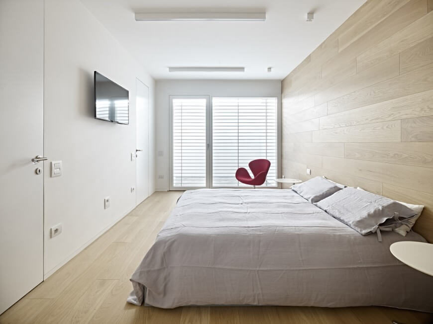 Instead Of A Headboard, This Gorgeous Wood Accent Wall Carries The Wood  Floor Up To