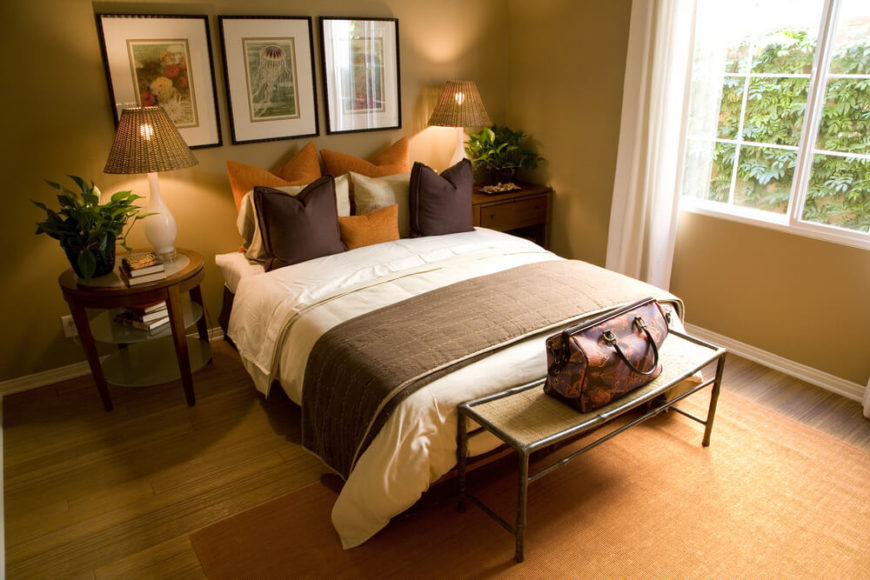 Delicieux Again Utilizing Decorative Pillows In Place Of A Headboard, This Brown And  Orange Bedroom Makes