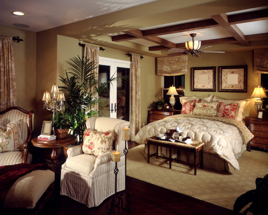 This richly textured and patterned room doesn't need a headboard to dress it up. The rest of the room does that well enough. Dark woods and bold accent patterns create enough depth in space that a headboard might end up being too much; instead pillows create the best replacement for a fancy headboard.
