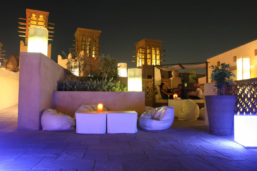 Beautiful A Rooftop Patio At Sunset Illuminated By Towers And Lanterns. Aside From A  Pergola Bench
