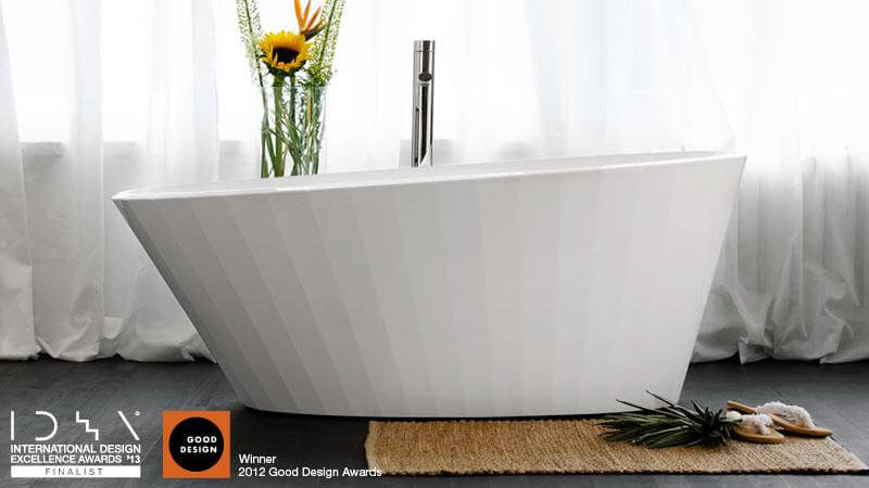 The award-winning Couture Collection features a slightly tilted design with fluted sides that evoke the image of a sea shell, or of a pleated skirt. This design is timeless and elegant, sure to inspire envy. The BCR 01 bathtub is available in True High Gloss™, matte, or a dual finish. The BCR 01 tub is limited edition, with only 2,000 units to be produced. The couture collection won a 2012 Good Design Award, presented by The Chicago Atheneaum: Museum of Architecture and Design.