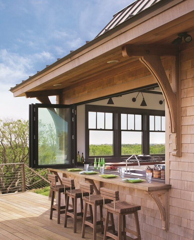 This home features a bar counter on the deck. The wooden bar stools match the deck.