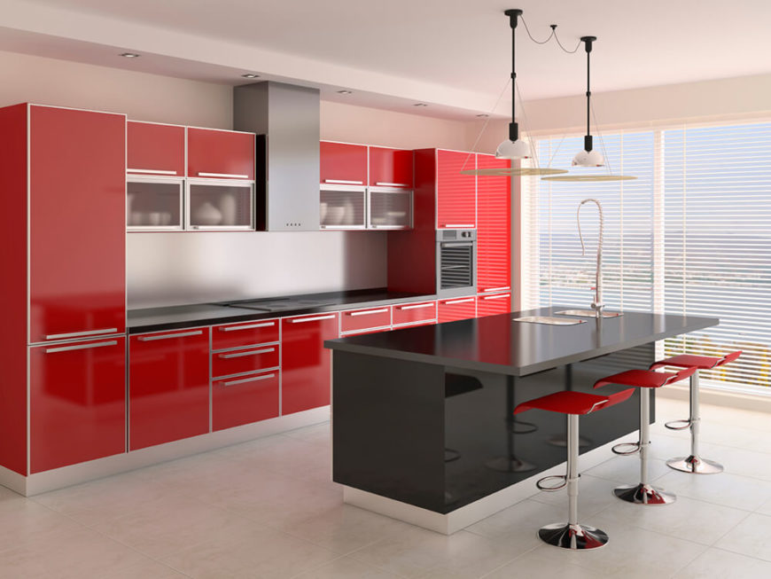 A 3-D rendering of a modern rectangular kitchen with bold red cabinets and a glossy black eat-in bar. Extensive window to the right have slim blinds that can be closed for privacy.