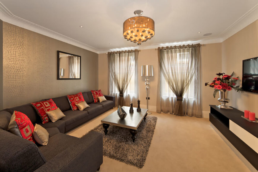 Warm Lighting And A Plush Carpet Makes This Living Room Very Comforting.  The Chrome Lamp