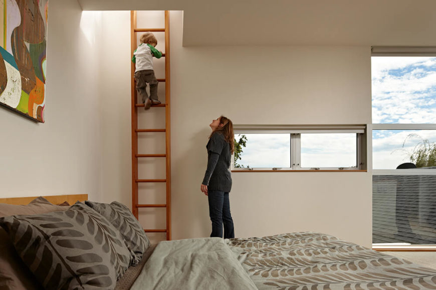 On the other side of the bed is a small wooden ladder that leads to a glass hatch to the rooftop patio, which has the best views in the house.