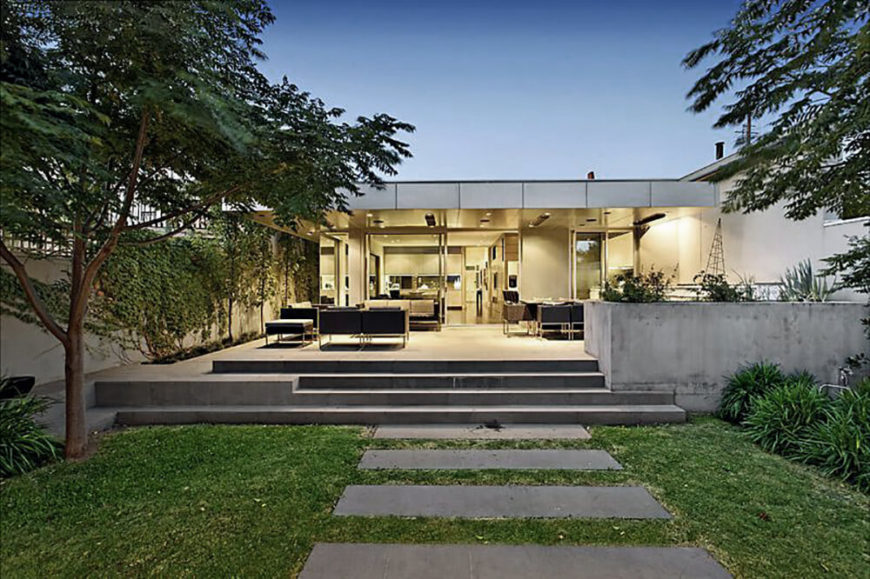 Seen from the privacy of the expertly manicured back yard, the home is an open, ultra-modern space that appears welcoming and well-equipped, and entirely integrated within the landscape.