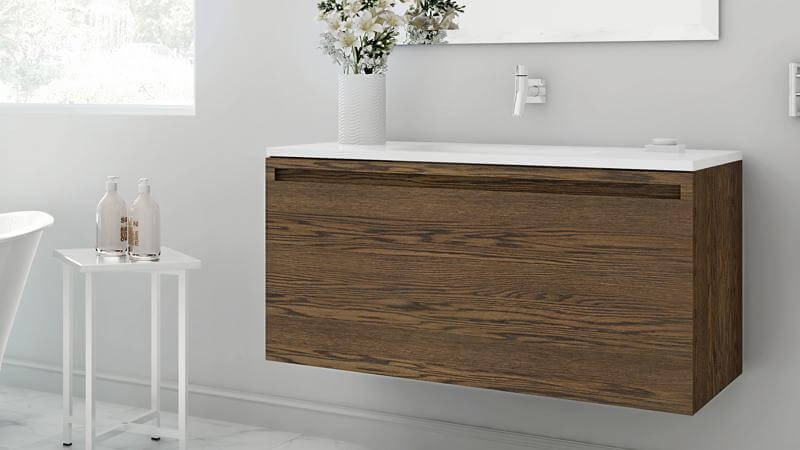 The 39 inch vanity is shown here in the Mocha, a lovely lighter option with a more prominent wood grain. Shown against a pristine whine bathroom, the oak grain and lighter finish contrast more subtly than the darker charcoal finish. Like other Element vanities, the 39 inch has the option of a pull-out inner drawer.
