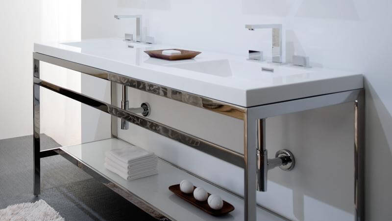 The largest of the C Collection stainless steel console vanities has a dual-sink integrated countertop that is molded in a single piece to ensure a seamless appearance. Unlike smaller models, the C60 has only one choice of sink style.