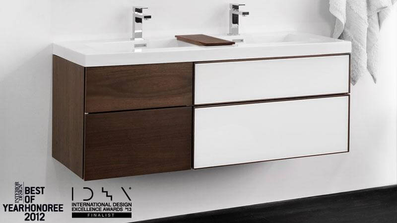 This vanity features multiple drawer configurations, push-to-open glides, and a multi-tonal design that contrasts with itself. The white panels shown are lacquered color glass.