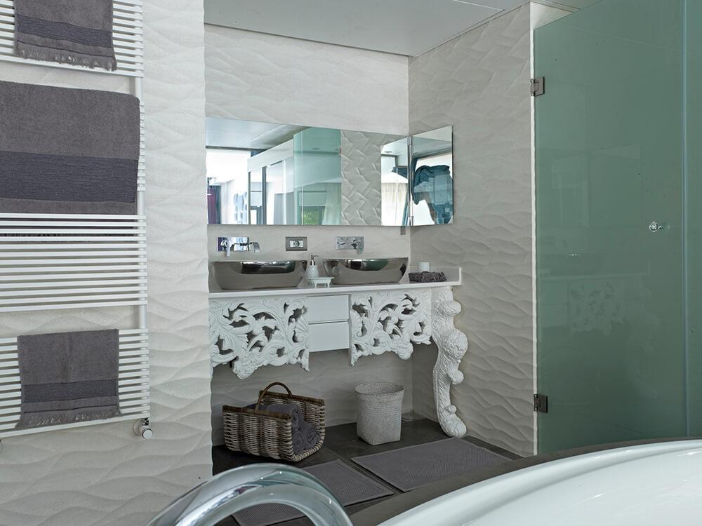 This master bathroom boasts stylish walls, a walk-in shower and a nice soaking tub.