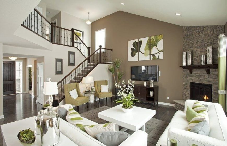 This gorgeous living room features a unified color palette, courtesy of  deep brown flooring,