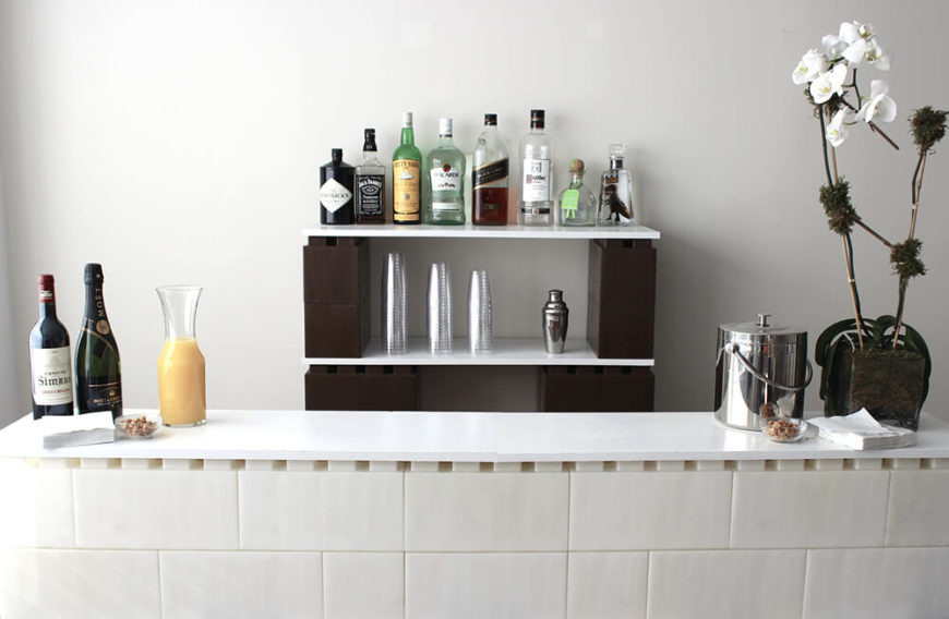 This is an entire home dry bar formed out of EverBlocks and a few simple flat white boards. Notice how the interlocking pieces create a continuous facade for the bar itself, while a set of smaller blocks makes shelf space in the background. One mimosa, please!