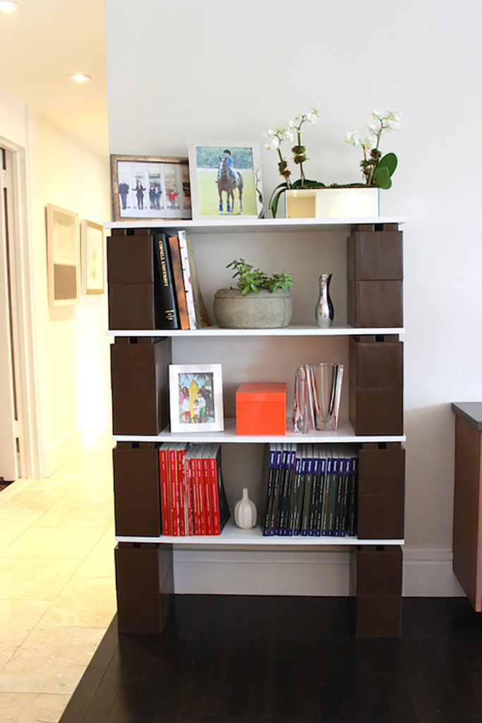 In a bright living room setting, we see the brown blocks used to create a bespoke bookshelf. If your library expands, you can always add more shelving.